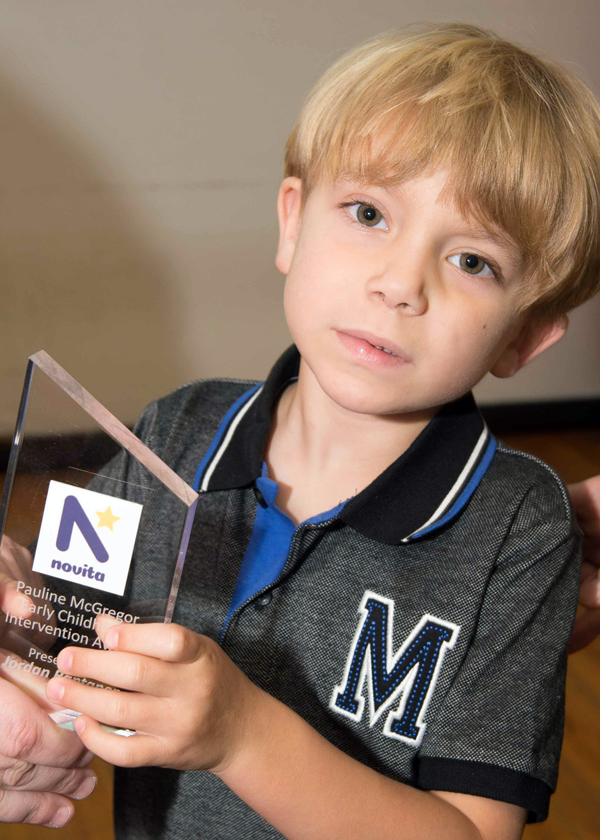 Jordan holding his award