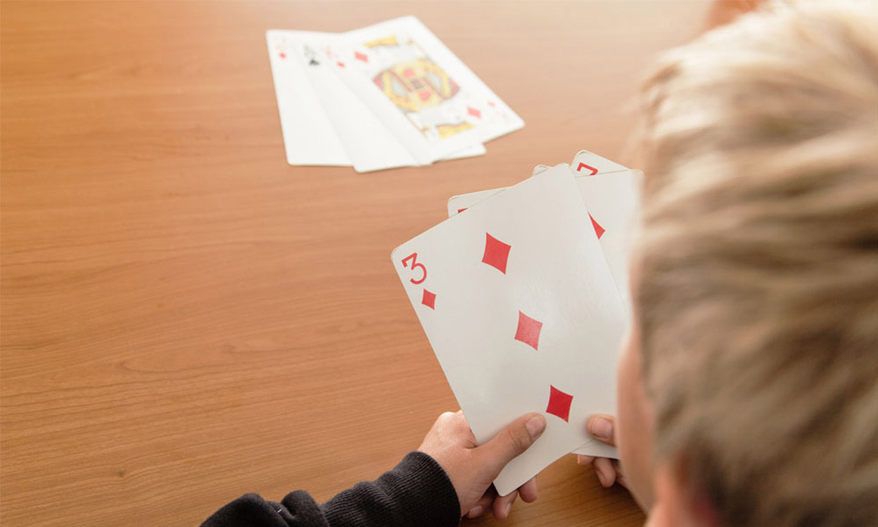 Boy playing Go Fish